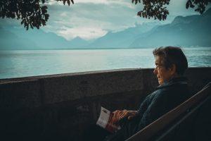 old man looking at lake.