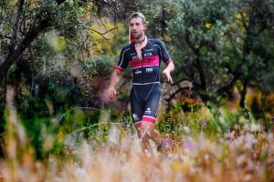 man running through bush